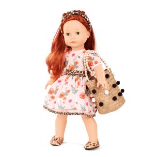 Stehpuppe mit roten Haaren und Blümchenkleid